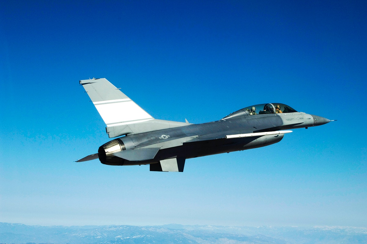 The U.S. Air Force's F-16D Automatic Collision Avoidance Technology (ACAT) aircraft cruises during a flight originating from…