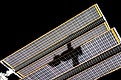The shadow of the Soyuz TMA-14 spacecraft is visible against solar array panels of the International Space Station during the relocation of the Soyuz from the Zvezda Service Module's aft port to the Pirs Docking Compartment. Original from NASA. Digitally enhanced by rawpixel.