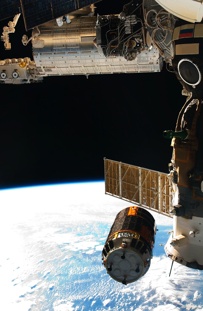Backdropped by Earth's horizon and the blackness of space, the unpiloted Japanese H-II Transfer Vehicle, filled with…