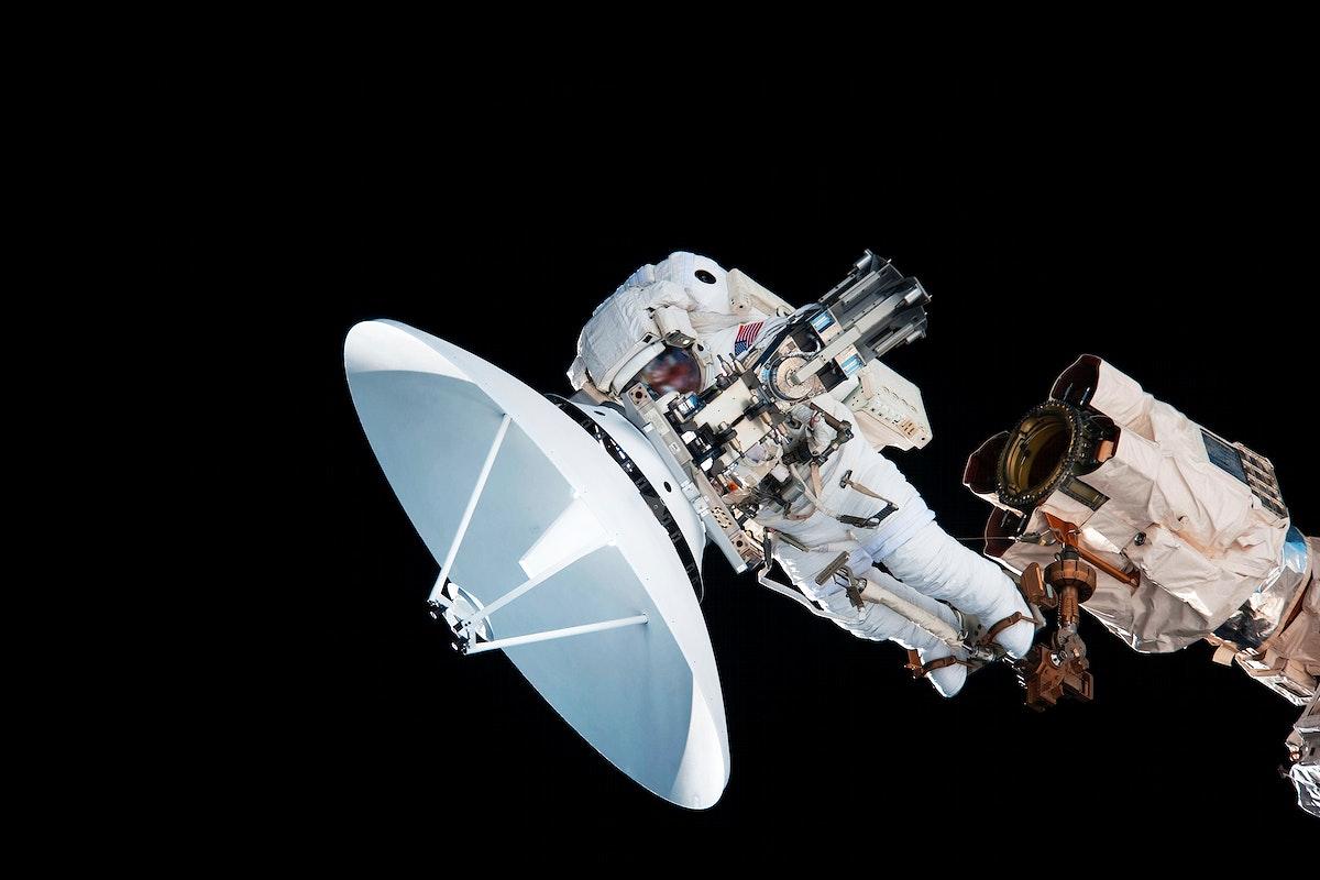 NASA astronaut Garrett Reisman during EVA 1. Original from NASA. Digitally enhanced by rawpixel.