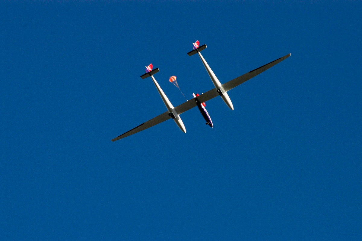 The Virgin Atlantic Airways GlobalFlyer aircraft sails across the sky near NASA Kennedy Space Center's Shuttle Landing…