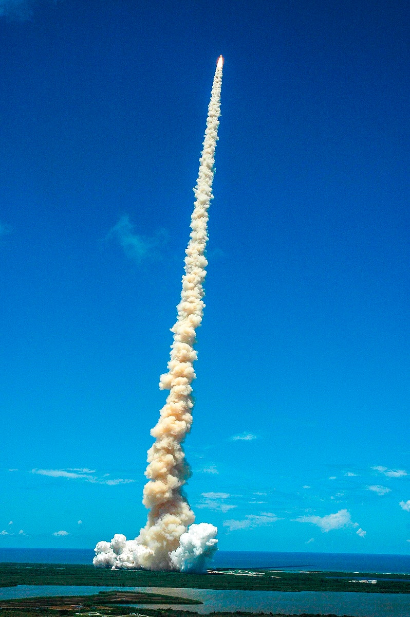 Shooting like a roman candle into Florida's blue sky, Space Shuttle Discovery kicks off the Fourth of July fireworks with its…