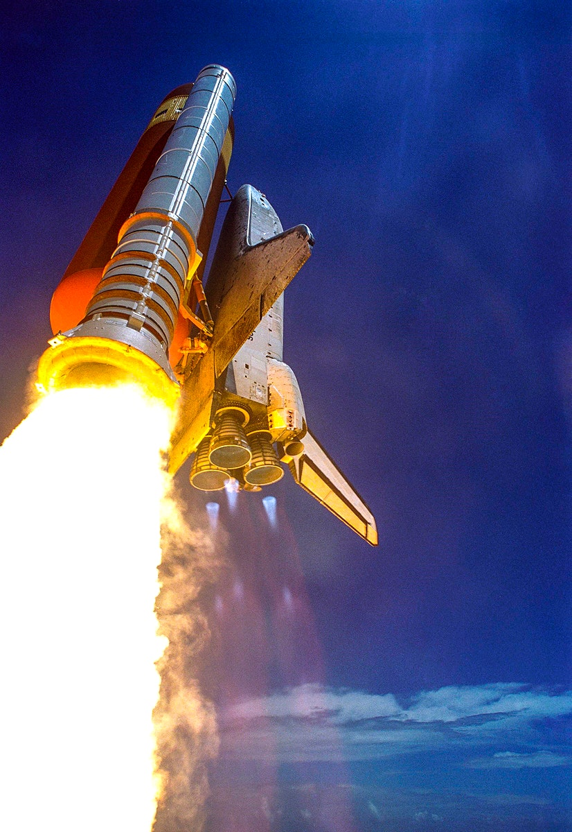 Making history with the first-ever launch on Independence Day, Space Shuttle Discovery rockets into the blue sky on mission…
