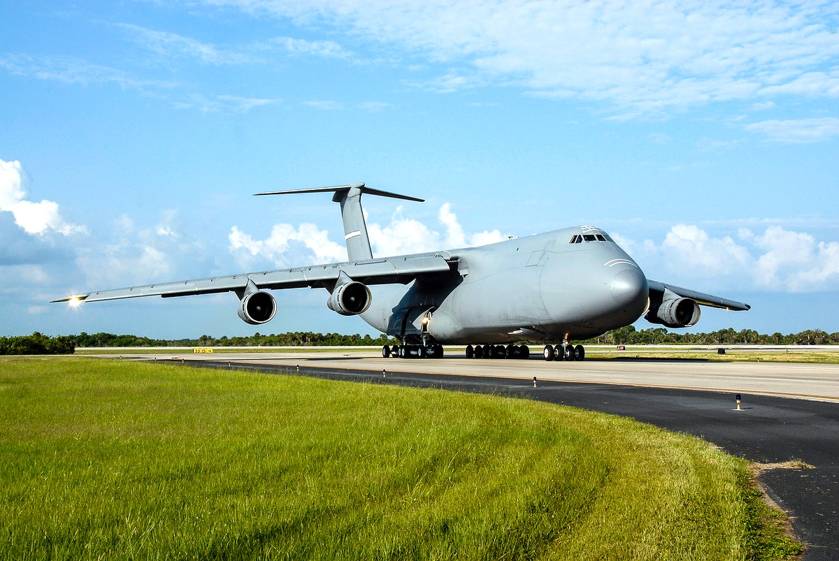 The U.S. Air Force C-17 aircraft arrives at NASA Kennedy Space Center's Shuttle Landing Facility with its SV-1 cargo of the…