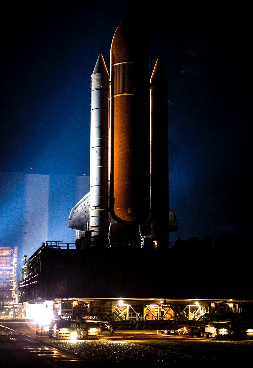 Xenon lights illuminate space shuttle Discovery as it makes its nighttime trek, known as rollout, from the Vehicle Assembly…