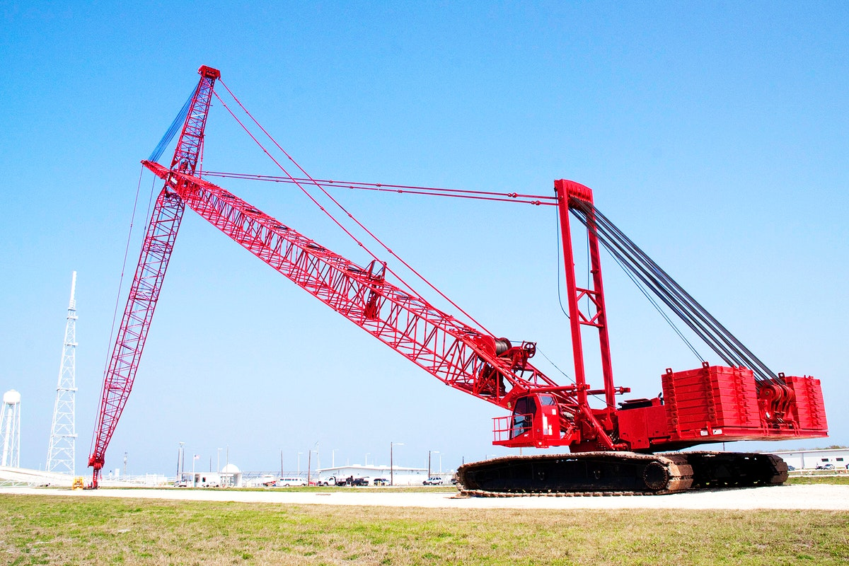 At NASA's Kennedy Space Center in Florida, a heavy-duty crane is slowly making its way to Launch Pad 39B. Original from NASA…