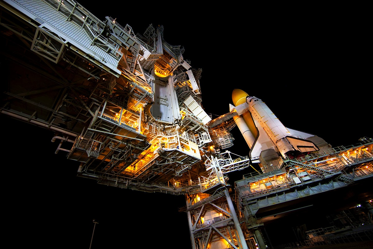 Space shuttle Atlantis, attached to its bright-orange external fuel tank and twin solid rocket boosters on Launch Pad 39A at…