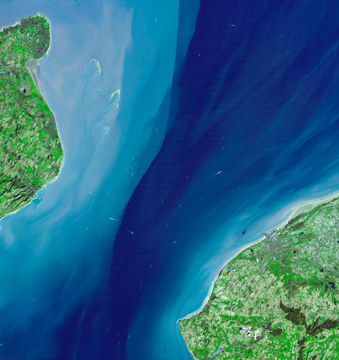 The Channel Tunnel, a 50.5 km-long rail tunnel beneath the English Channel at the Straits of Dover. Original from NASA.…