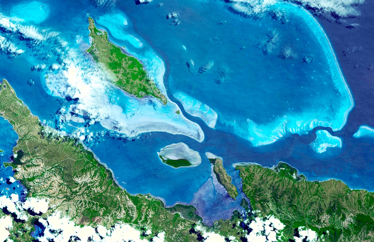 In this image, taken by NASA's Terra spacecraft, six marine clusters represent the main diversity of coral reefs and…