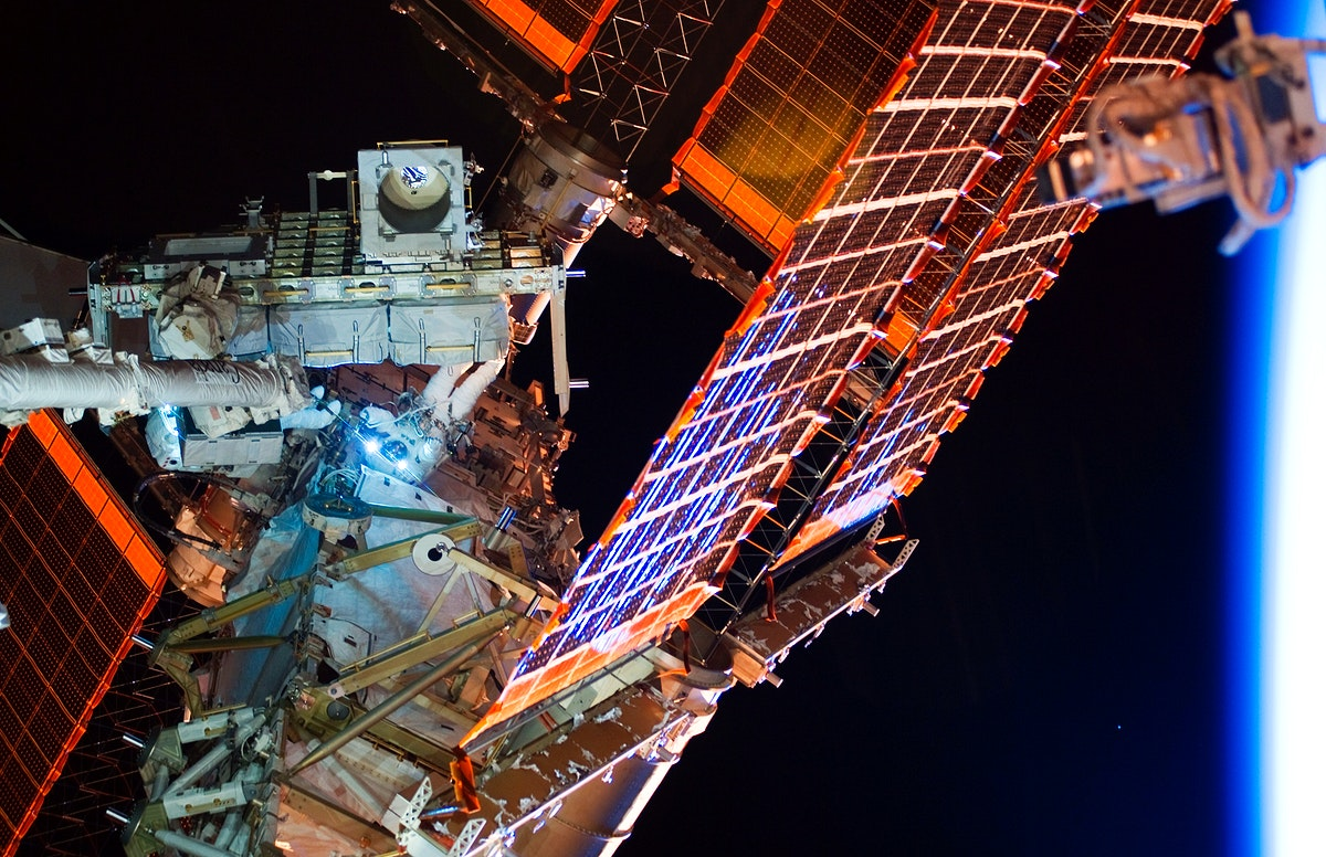 View of the crew members outside of the International Space Station on 21 May 2010. Original from NASA. Digitally enhanced by…