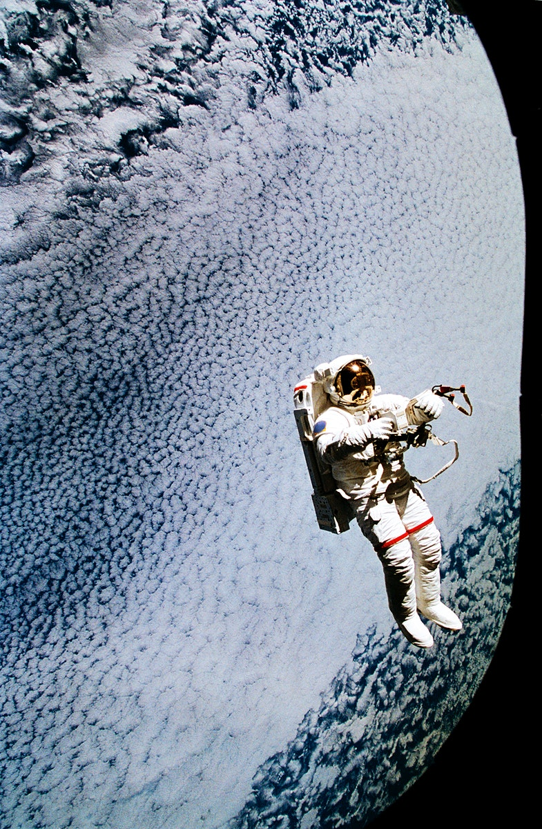 Astronaut Mark C. Lee floats freely as he tests the new Simplified Aid for EVA Rescue (SAFER) system. Original from NASA.…