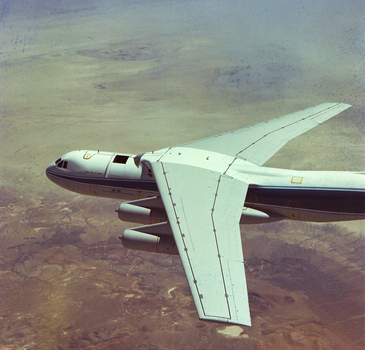 C-141 (NASA-714) Kuipter Airborne Observatory in flight, telescope hatch open. Original from NASA. Digitally enhanced by…