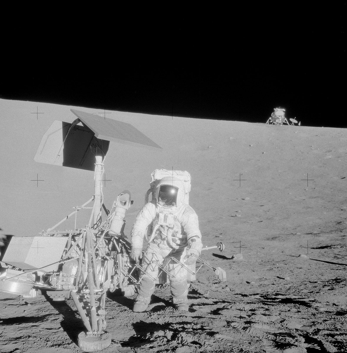 Astronaut Charles Conrad Jr., commander, examines the unmanned Surveyor 3 spacecraft during the second Apollo 12…