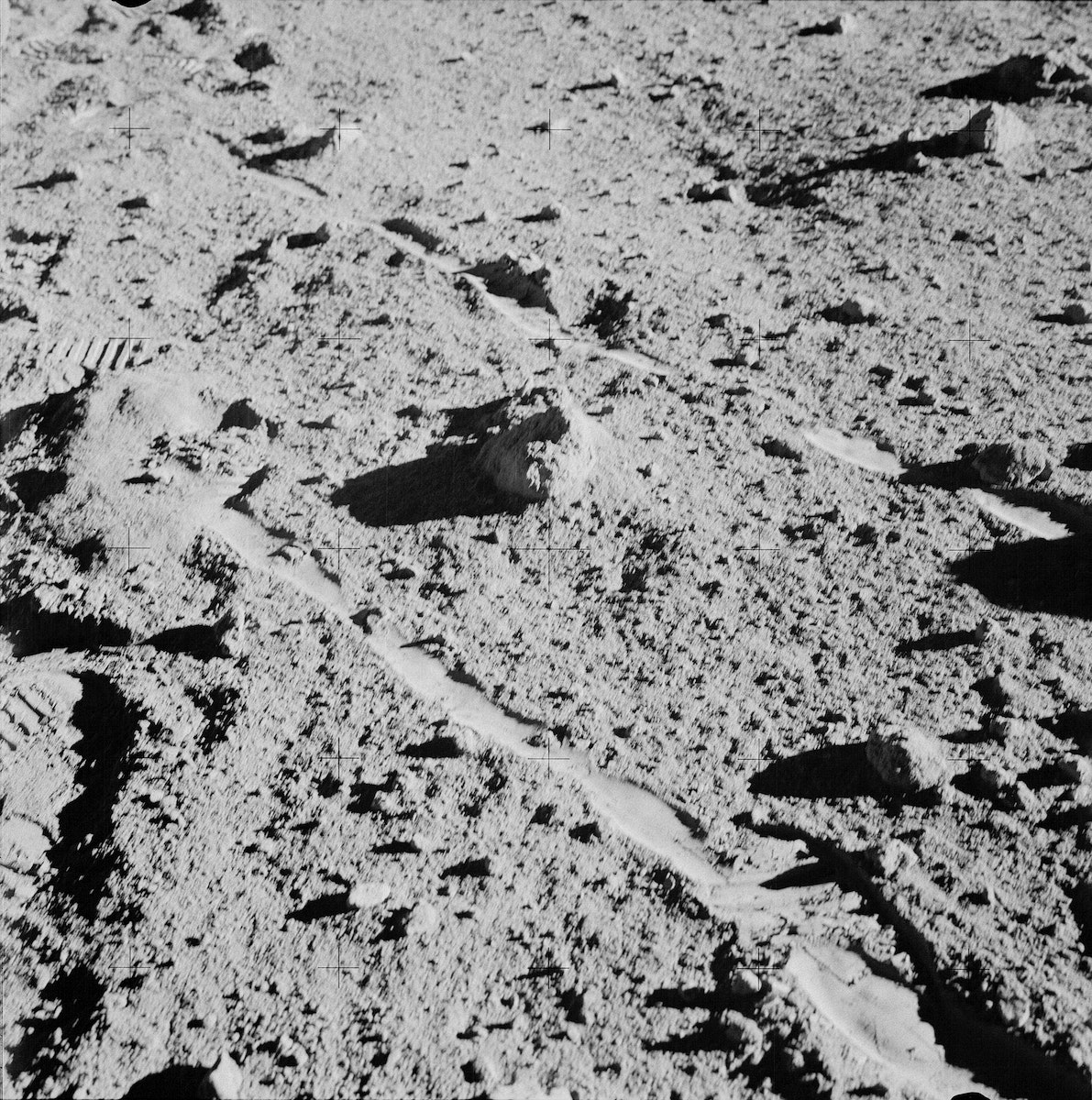 Two moon-exploring crew men of the Apollo 14 lunar landing mission, photographed and collected the large rock pictured just…