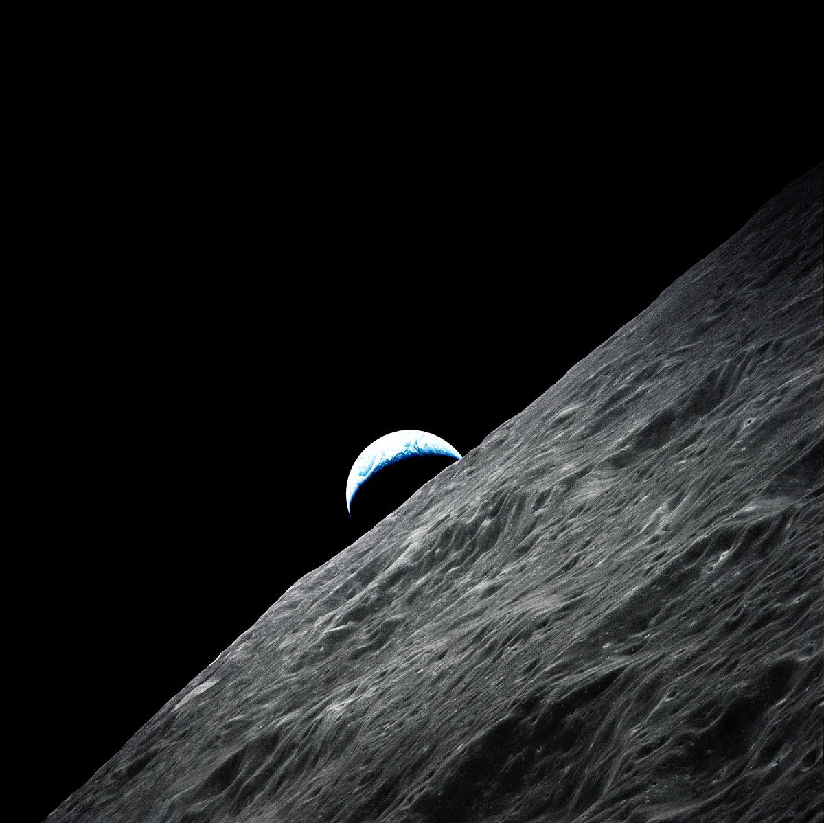 Crescent Earth rises above the lunar horizon taken during the Apollo 17 mission. Original from NASA. Digitally enhanced by…
