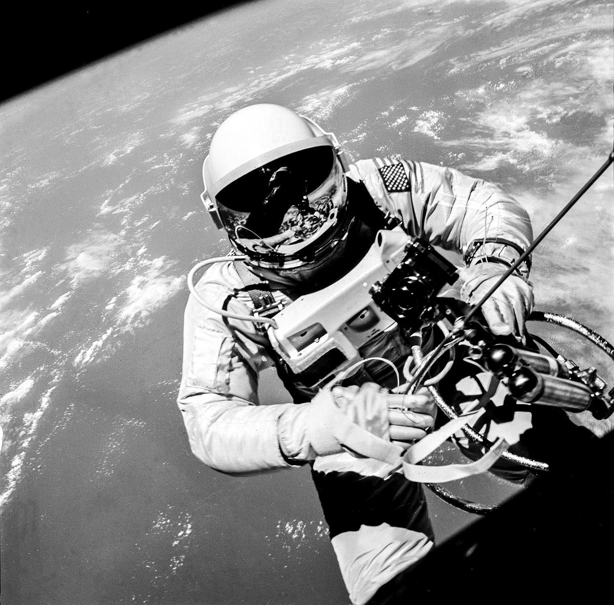 Astronaut Edward H. White II, pilot on the Gemini-Titan IV (GT-4) spaceflight, floats in the zero gravity of space outside…