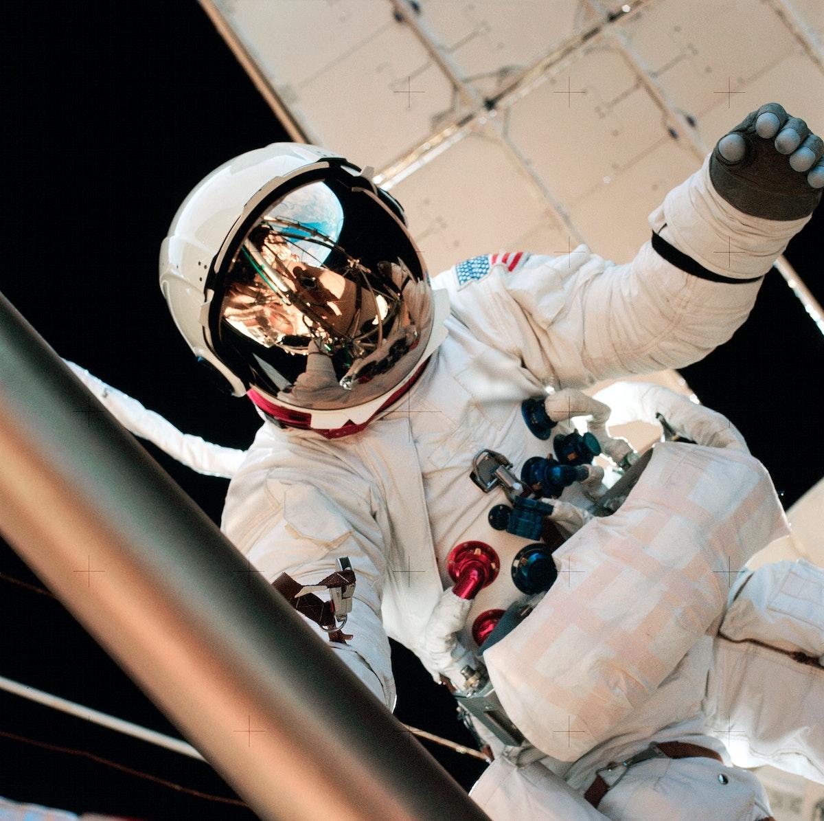 Astronaut Jack Lousma participates in EVA to deploy twin pole solar shield. Original from NASA. Digitally enhanced by…