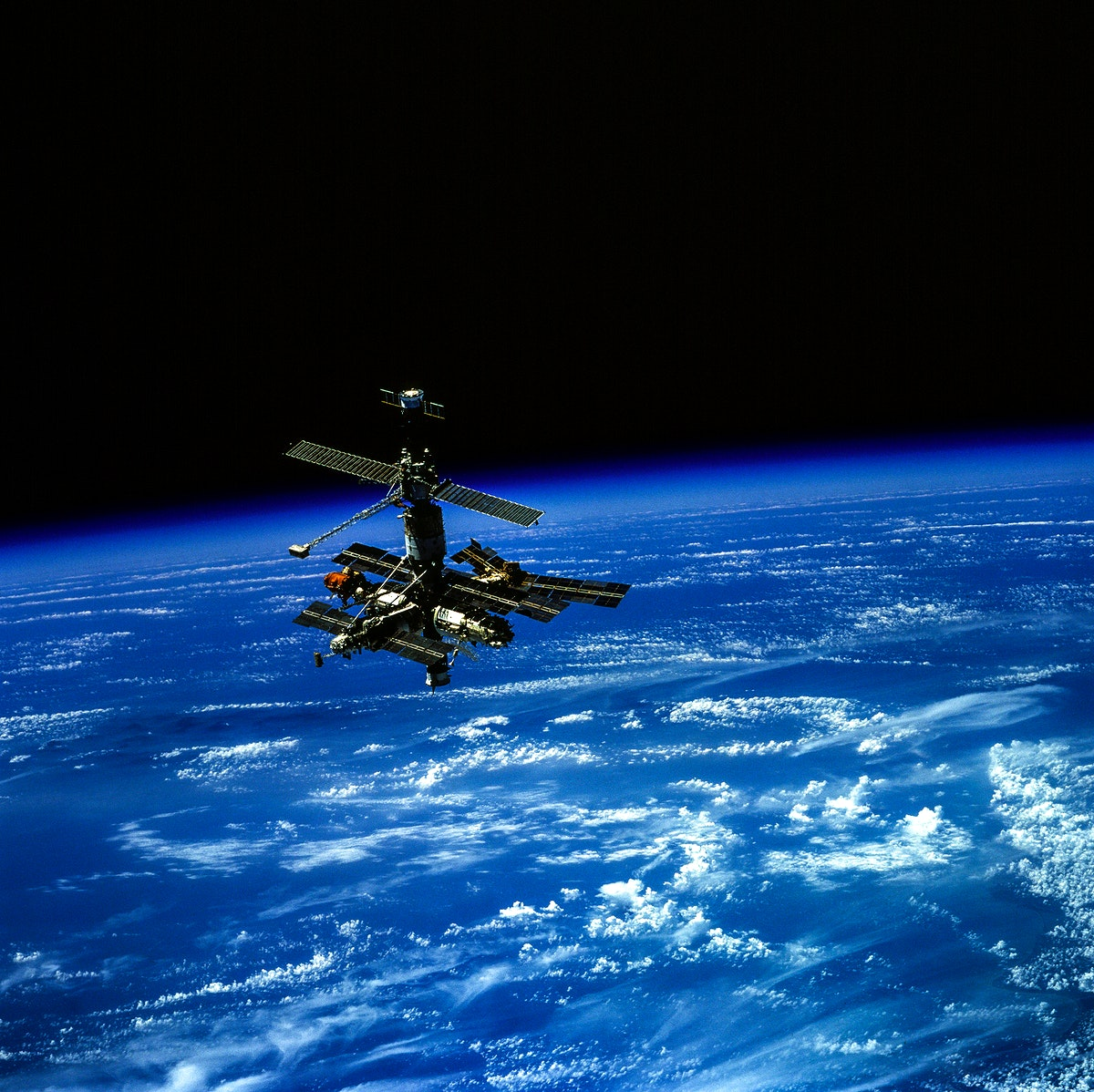 Russia's Mir Space Station, backdropped over Earth's horizon. Original from NASA. Digitally enhanced by rawpixel.