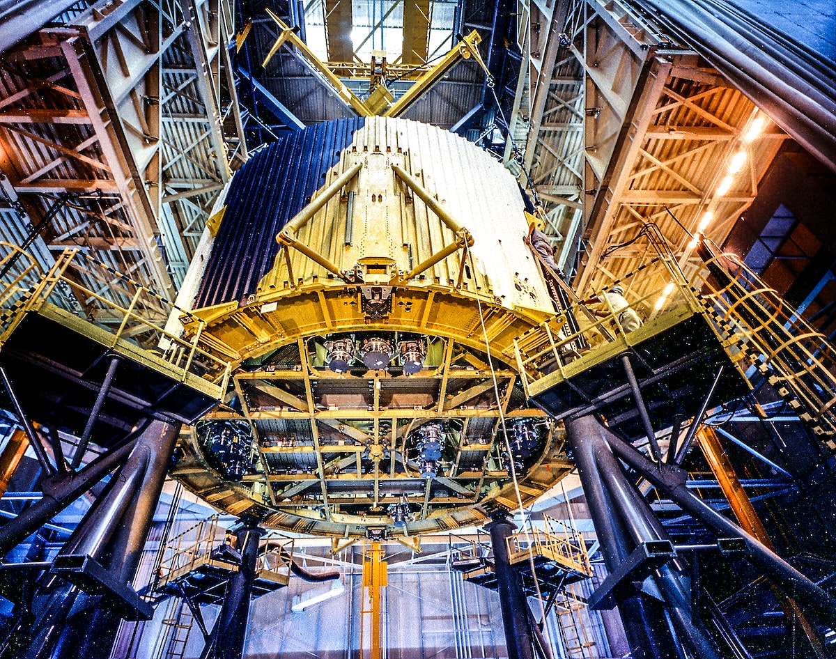 Saturn Apollo Program. This photograph is a view of stacking the major components of the S-IC (first) stage of the Saturn V…