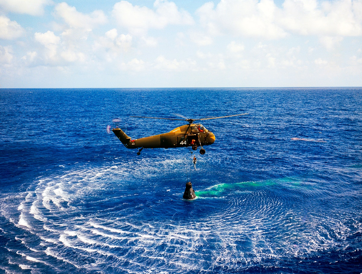 Astronaut Alan B. Shepard Jr. is rescued by a U.S. Marine helicopter at the termination of his suborbital flight May 5, 1961.…
