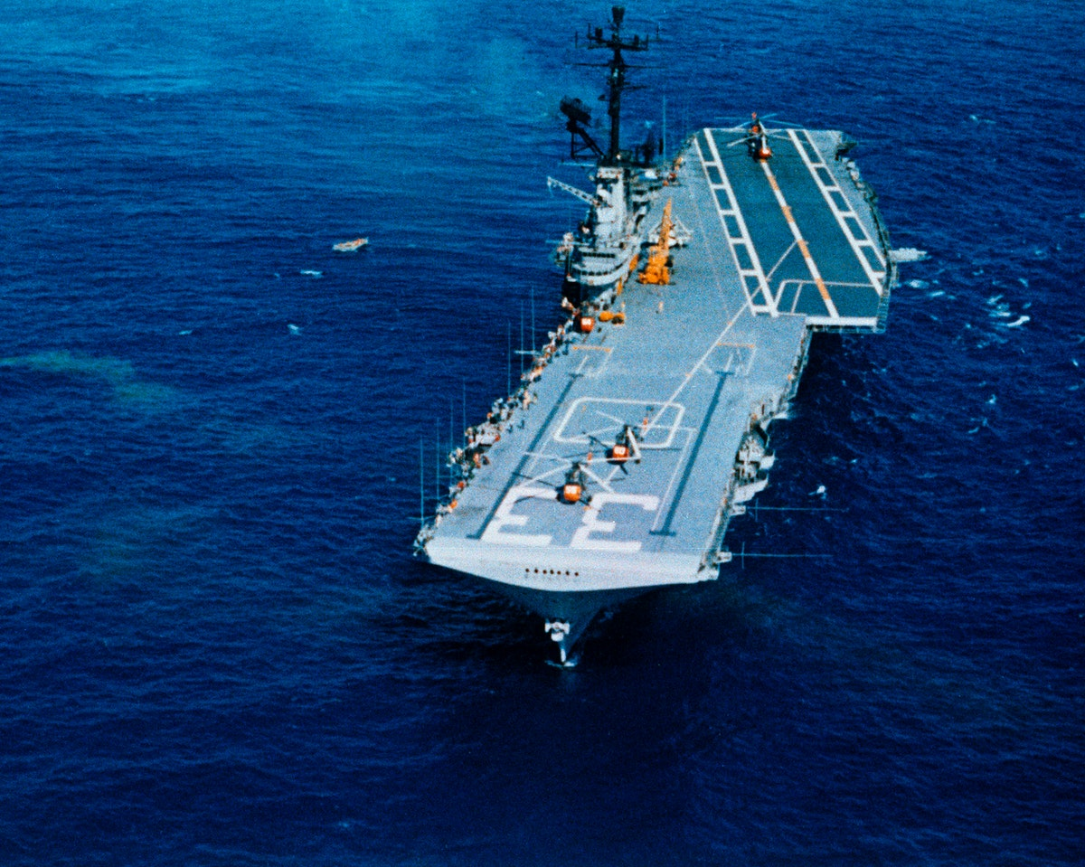 Aerial view of the U.S.S. Kearsarge, recovery ship for the Mercury-Atlas 8 mission. Original from NASA. Digitally enhanced by…