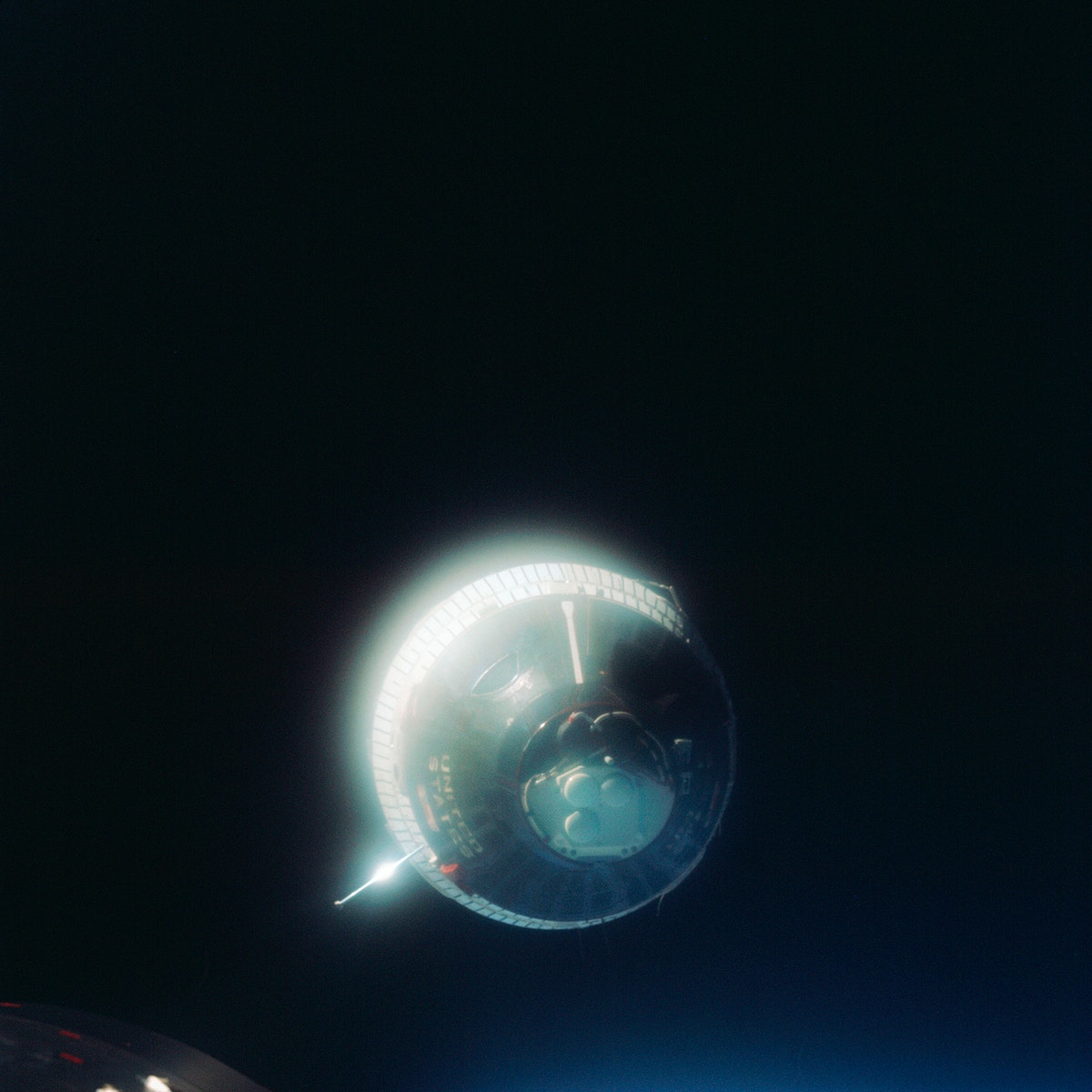 The Earth-orbiting Gemini-6 spacecraft against the blackness of space. Original from NASA. Digitally enhanced by rawpixel.