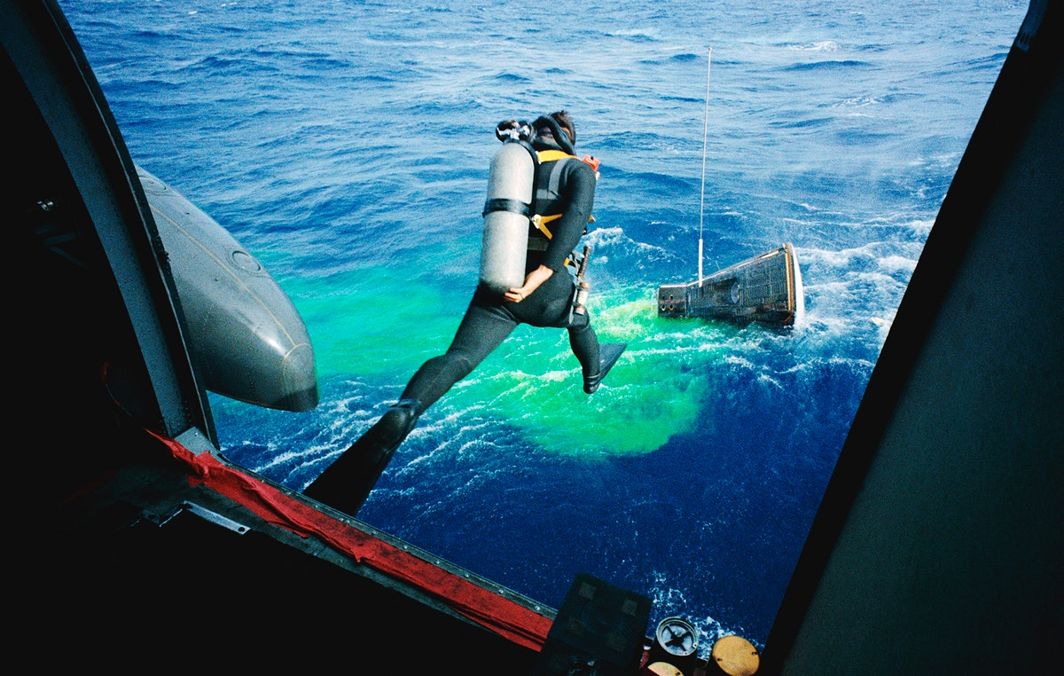 A Navy frogman leaps from a recovery helicopter into the water to assist in the Gemini-12 recovery operations. Original from…