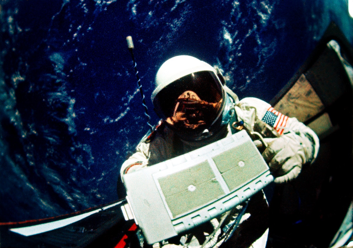 Astronaut Edwin E. Aldrin Jr., pilot for the Gemini-12 spaceflight, removes micrometeoroid package for return to the…