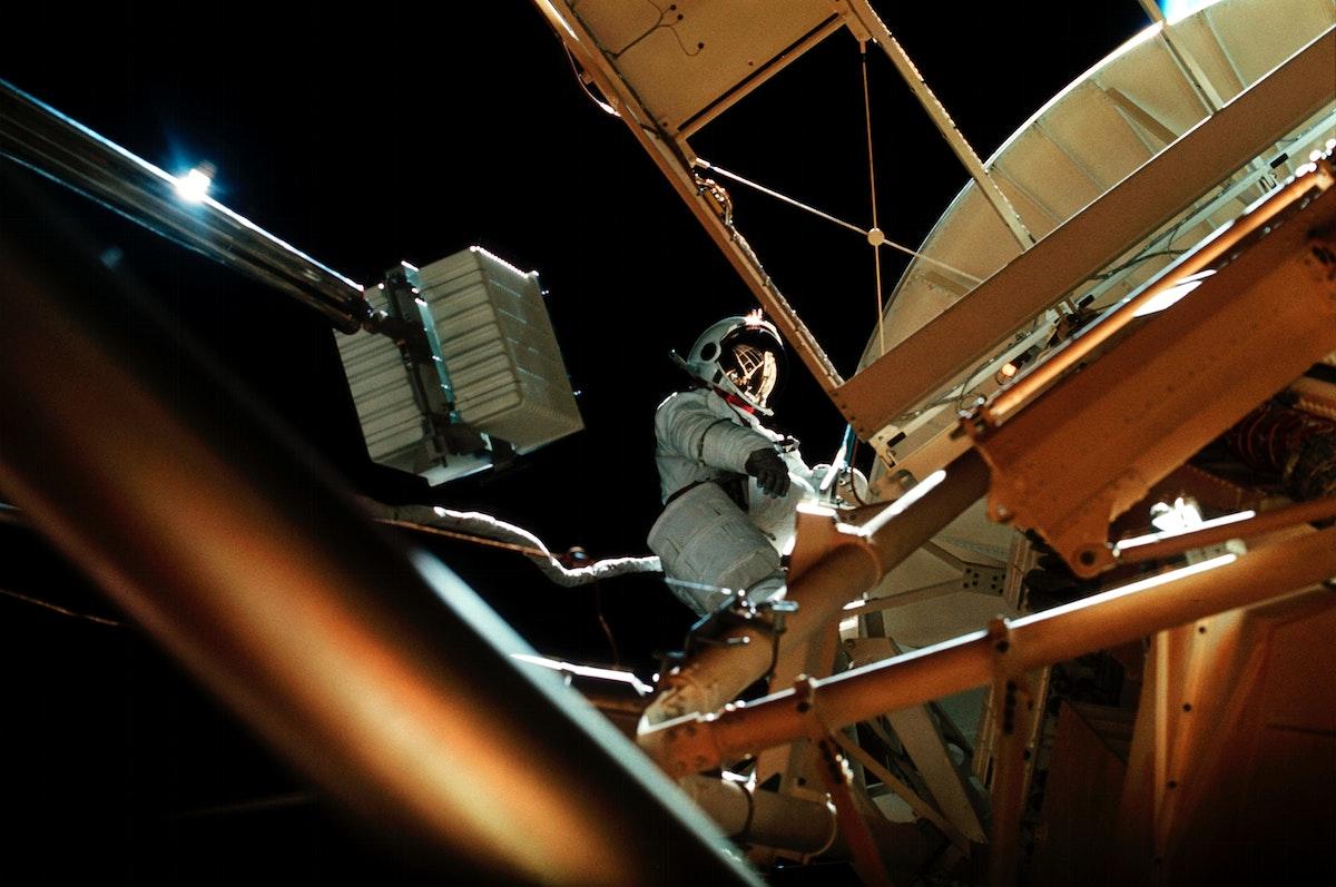 Astronaut participates in EVA to deploy twin polar shield. Original from NASA . Digitally enhanced by rawpixel.