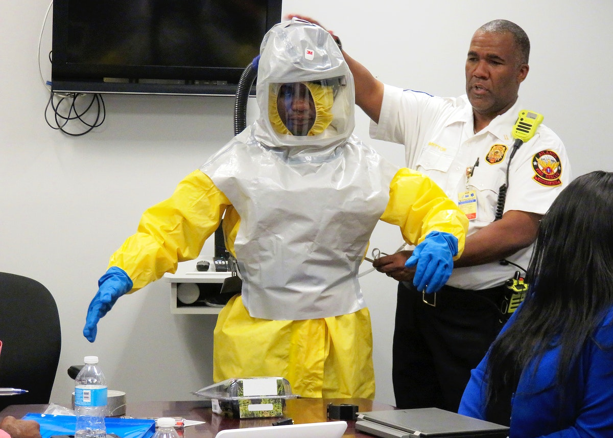 CDC's Atlanta Quarantine Station staff working with public health partners Original image sourced from US Government…