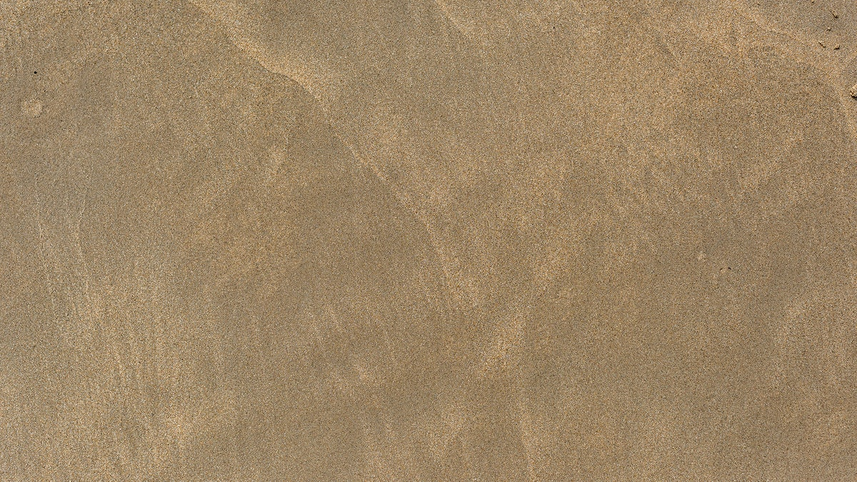 Natural sand on the beach background