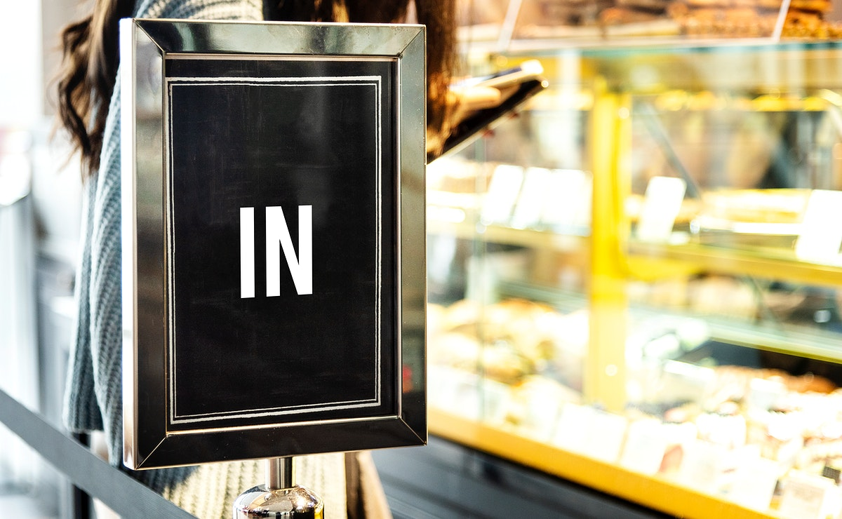 In sign mockup at the front of a cafe