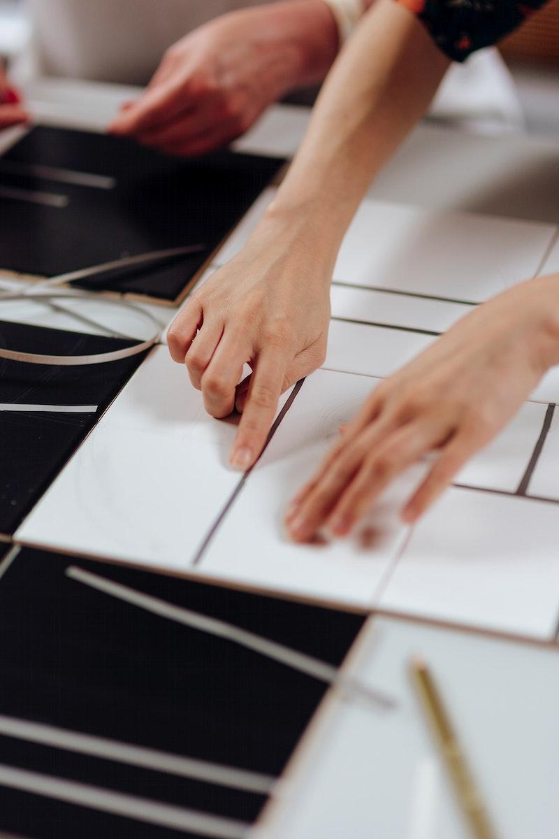 Designer cutting a pattern in a paper