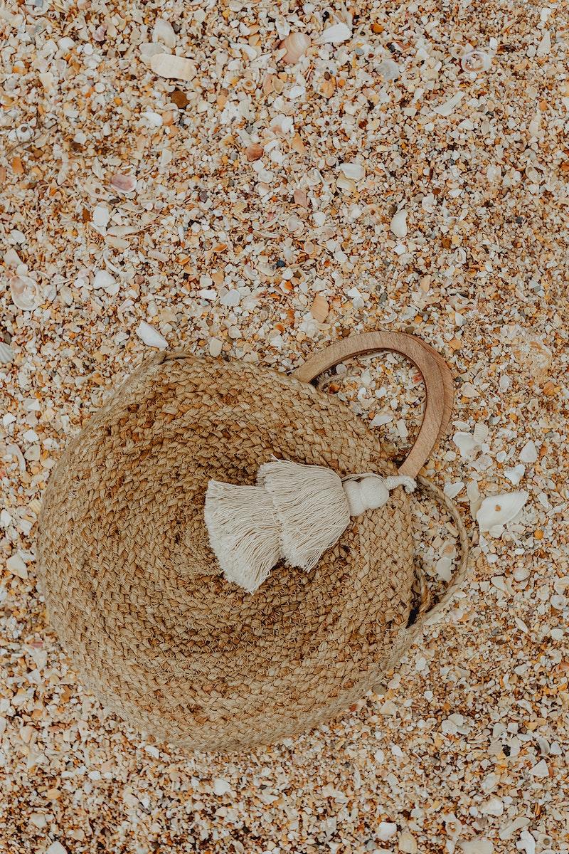 Handmade beach bag left in the sand