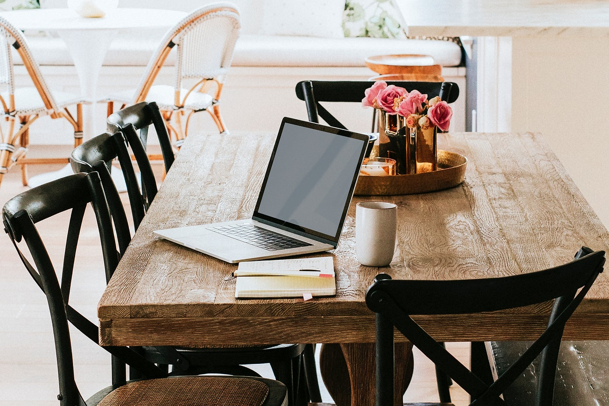 Notebook on a wooden dining table