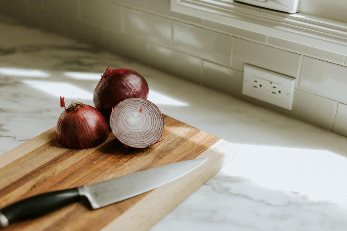 Freshly sliced onion on a cutting board