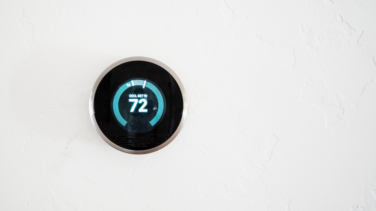 Digital modern thermostat at home