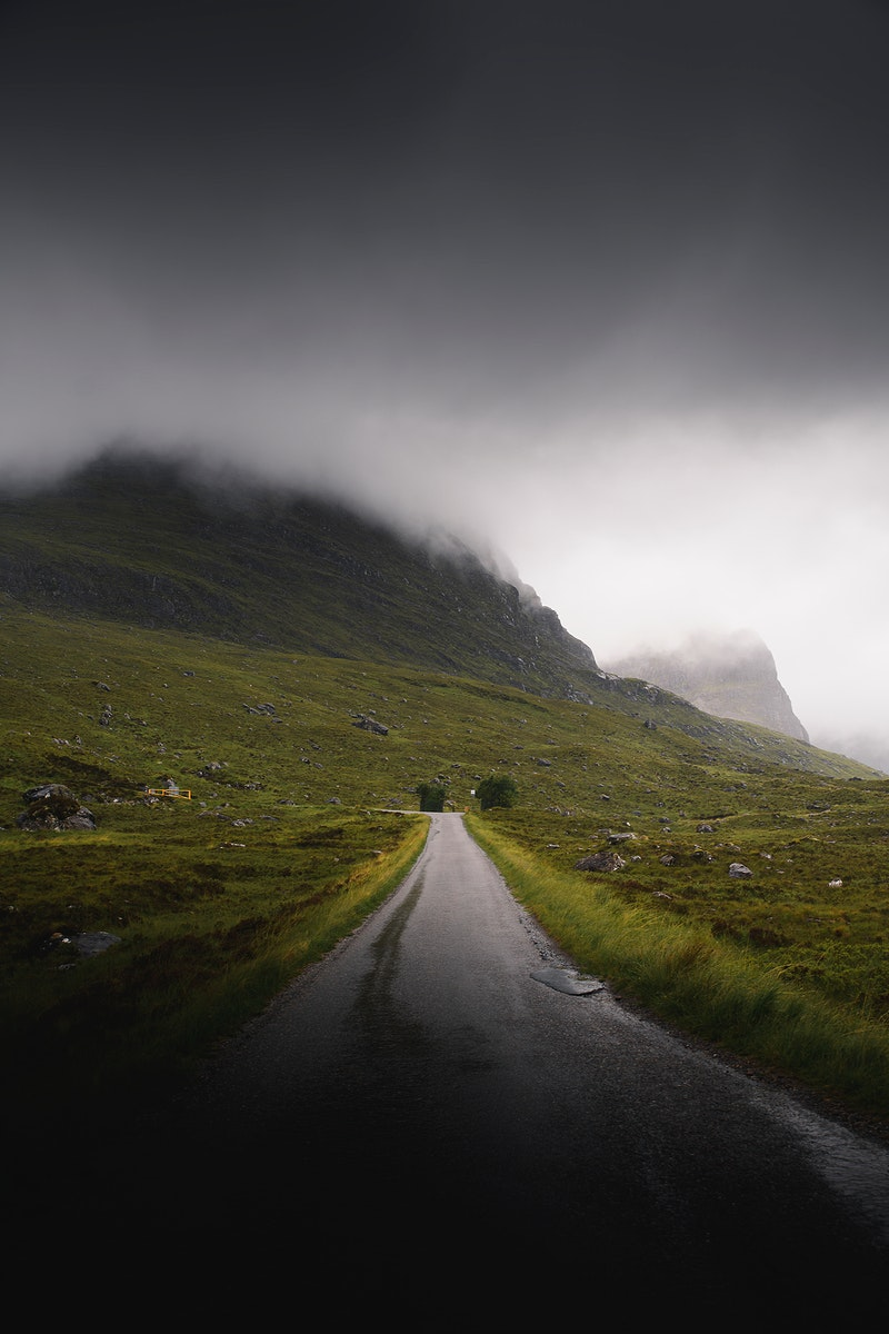 Scenic route leading to a misty mountain