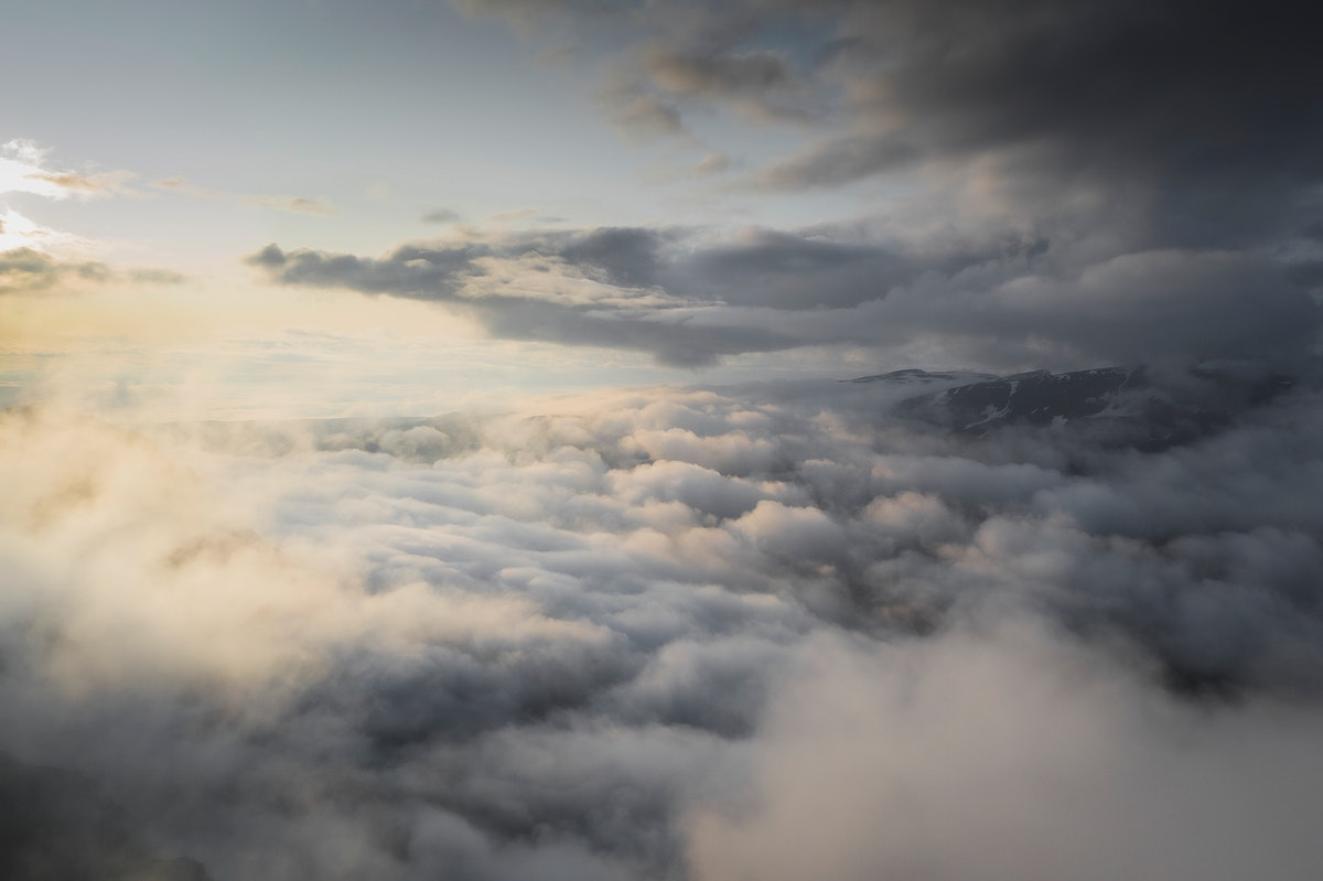Cloudy sky over mountains background