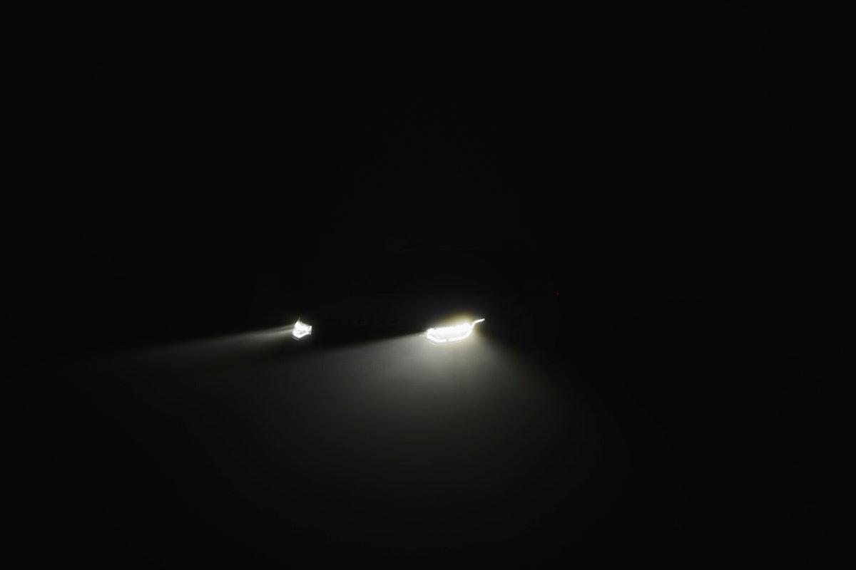 Car headlighs in the dark
