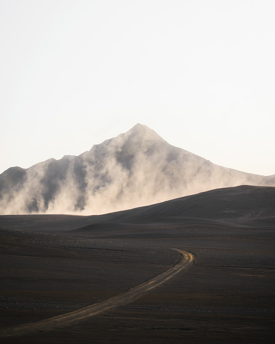 Curve road with a misty volcanic drone shot