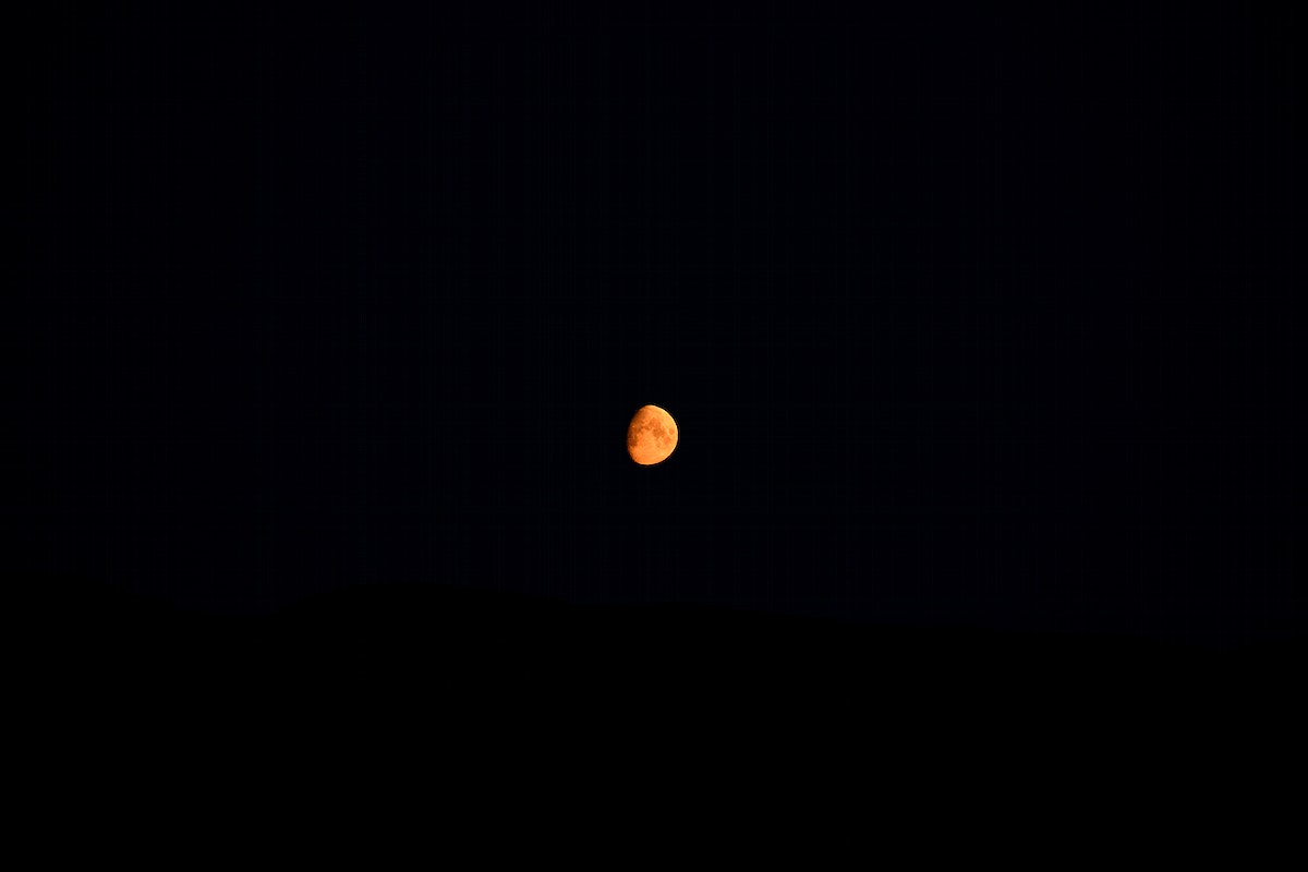 Red moon in a night sky