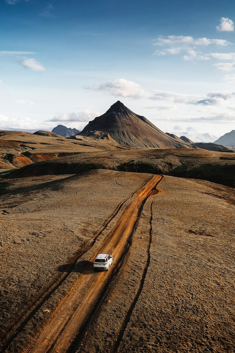 2019, Iceland, White Landrover driving on a dusty sand road