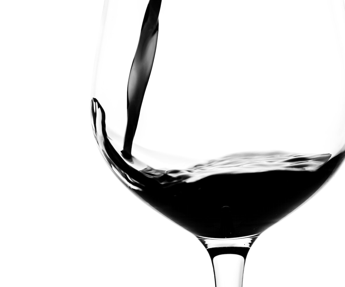 Pouring a glass of red wine