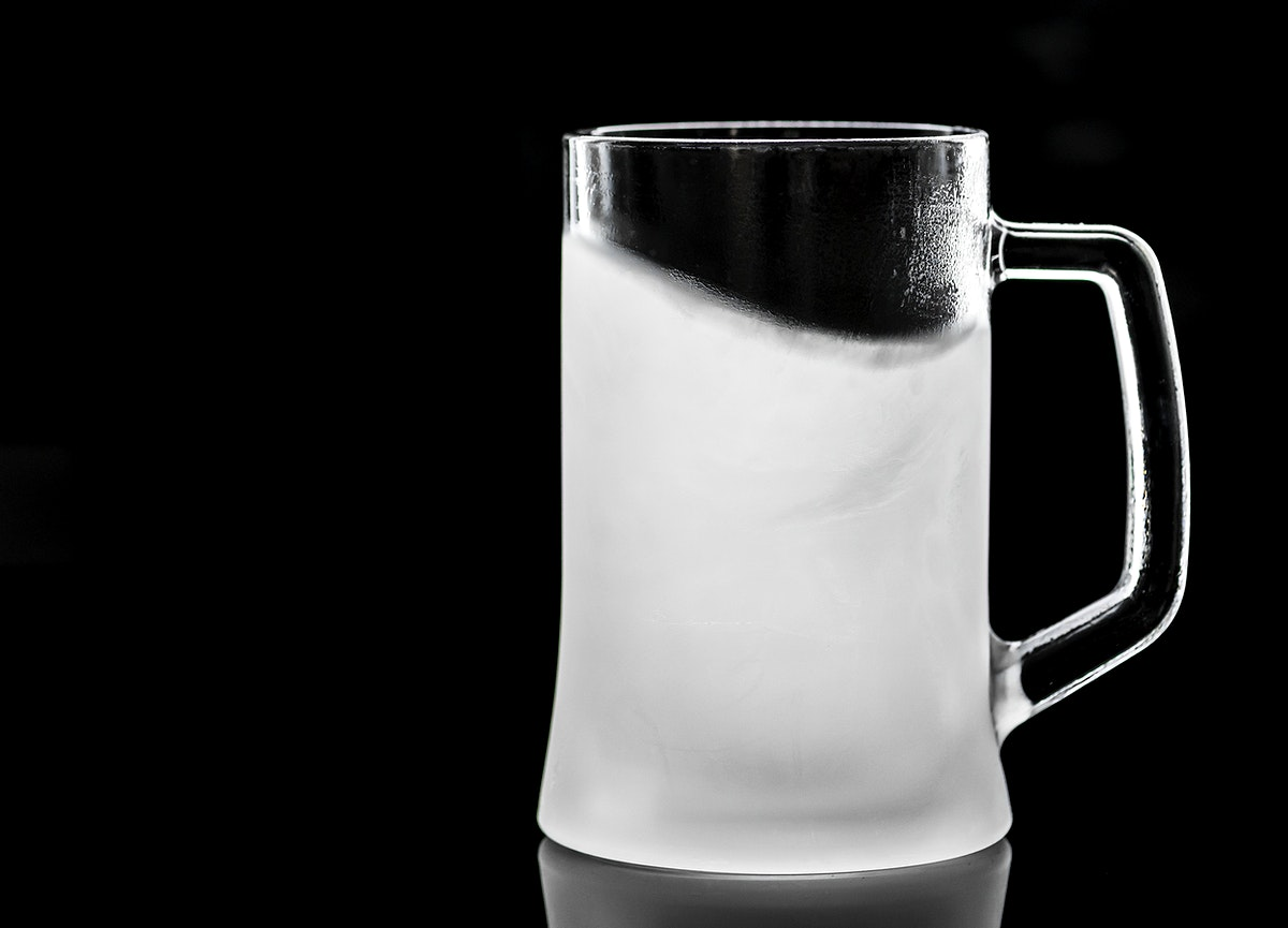 Frosted empty beer glass macro photography