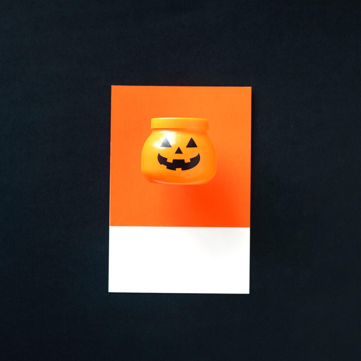 A jar with a pumpkin face