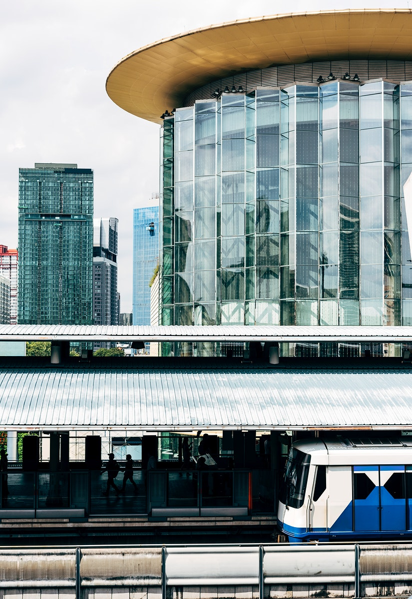 View of skytrain station and a glass building in downtown