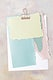 Blank torn pastel paper templates set with a paperclip
