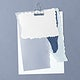 Blank torn blue paper templates set with a paperclip