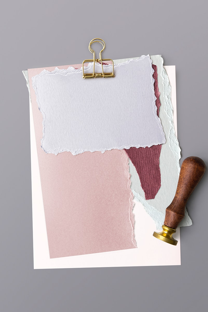 Blank torn pink paper templates set with a paperclip